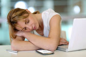 Office worker falling asleep during working hours — Stock Photo
