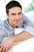 Modern guy relaxing at home in sofa — Stock Photo