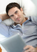 Man websurfing on internet with digital tablet — Stock Photo