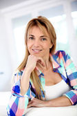 Portrait of attractive blond woman with hand on chin — Stock Photo