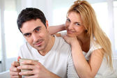 Middle-aged couple relaxing at home — Stock Photo