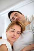 Couple taking a nap in sofa at home — Stock Photo