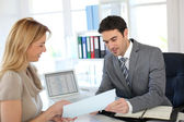 Woman meeting banker to set up her own business — Stock Photo