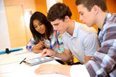 College students in training class with tablet — Stock Photo