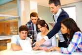 Group of students in computer training with teacher — Stock Photo