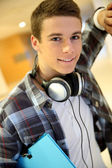Trendy young student boy with music headphones — Stock Photo