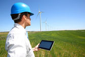 Businessman checking on wind turbine energy production — Stock Photo