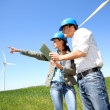 Engineers looking at wind turbine site with tablet — Stock Photo