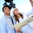 Stock Photo: Couple visiting Madrid and checking on city plan