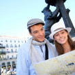Couple visiting Madrid and checking on city plan — Stock Photo