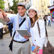 Couple visiting Madrid with help of digital tablet — Stock Photo