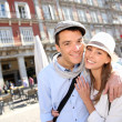 In love couple visiting la Plaza Mayor de Madrid — Stock Photo