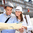 Couple of tourists looking at city map in Madrid — Stock Photo