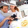 Tourists in Madrid checking on image shots — Stock Photo