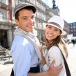 Couple of tourists visiting la Plaza Mayor de Madrid — Stock Photo