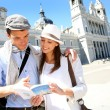 Tourists standing by the Almudena Cathedral of Madrid — Stock Photo