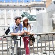 Couple standing in front of Madrid Royal Palace — Stock Photo #27930353