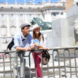 Couple standing in front of Madrid Royal Palace — Stock Photo