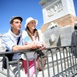 Couple standing in front of Madrid Royal Palace — Stock Photo #27930363