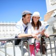Couple reading traveler book by the Royal Palace of Madrid — Stock Photo #27930369