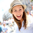 Portrait of cheerful beautiful girl in town — ストック写真