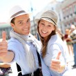 Cheerful couple in Madrid showing thumbs up — Stock Photo
