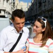 Couple of tourists in Gran Via avenue of Madrid — Stock Photo