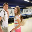 Couple of tourists waiting to get in train — Stock Photo