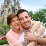 Couple standing by the Sagrada familia church, Spain — Stock Photo