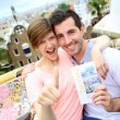 Stock Photo: Couple of travelers visiting Guell Park