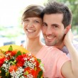 Girl receiving flowers from boyfriend — Stock Photo