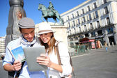 Couple checking on tourist information in Madrid — Stock Photo