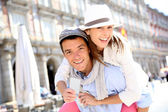 Cheerful couple holding visitor pass of Madrid capital — Stock Photo