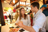 Couple in Madrid eating spanish savouries — Stock Photo
