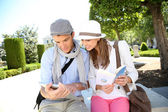 Tourists in Plaza de Oriente looking for information — Stock Photo