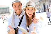 Couple with tablet showing thumbs up — Stock Photo