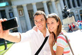 Couplle taking picture in front of Prado Museum, Madrid — Stock Photo