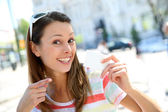 Cheerful girl in showing tourist pass — Stock Photo