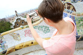Girl taking picture of Barcelona from Guell Park — Stock Photo