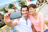 Couple taking picture of themselves in Guell park — Stock Photo