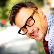 Trendy guy in eyeglasses and tie — Stock Photo