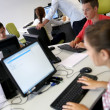 Young people in computer's lab — Stock Photo #35257491