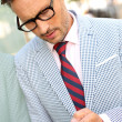 Trendy guy with eyeglasses and tie — Stock Photo #35252135