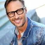 Guy wearing eyeglasses and blue jeans jacket — Stock Photo