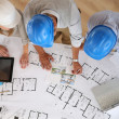 Architects working on blueprint — Stock Photo