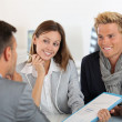 Stock Photo: Partners presenting business plan to investor