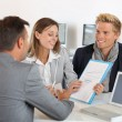 Partners presenting business plan to investor — Stock Photo