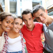 Cheerful students in college campus — Stock Photo