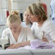 Stock Photo: Student with teacher in dressmaking class