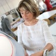 Dressmaker in training class — Stock Photo